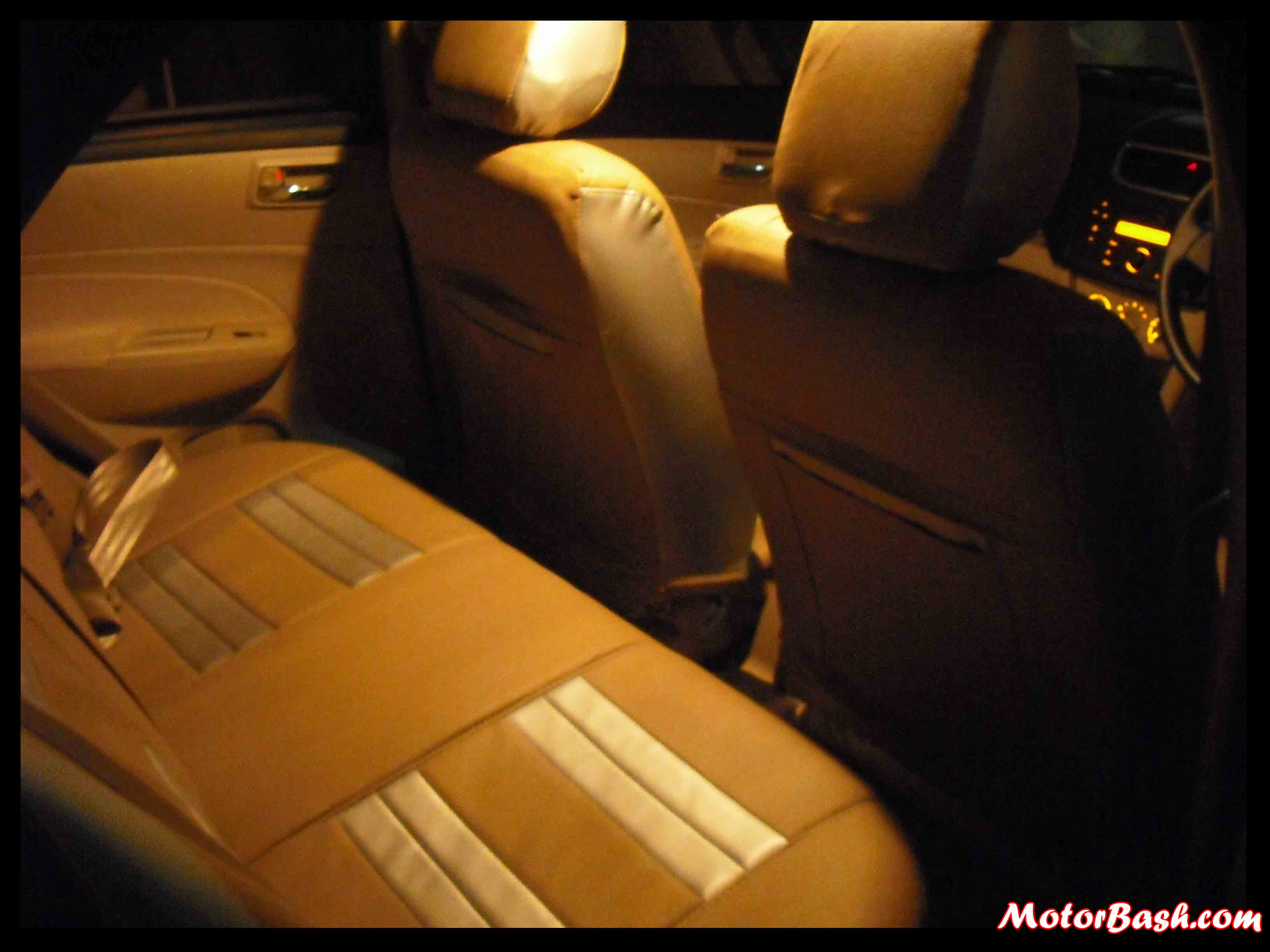 ….and back seats equally well. Check out the ambience at rear seat. Beige color really brightens the cabin.