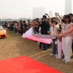 Mr Vijaypath Singhania flagging off the 5th Super Car Show